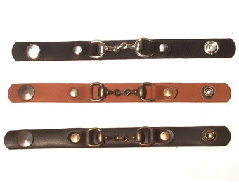 Leather wristband with horse bit and snap