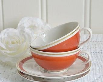 Demitasse cups with saucers, vintage Kaestner porcelain, orange and gold,  retro kitchenware