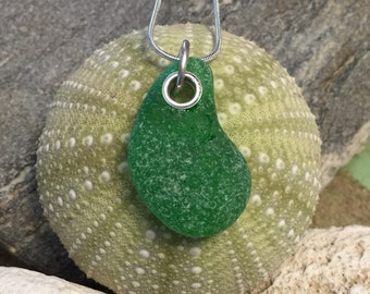 Sea glass jewelry- green sea glass set with Sterling silver grommet