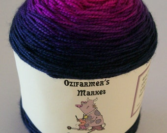 Ozimerino.  Hand-dyed hot pink to blue-black gradient yarn.  100gm. Mikiv