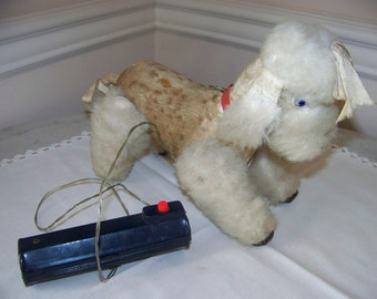 Poodle toy battery operated.