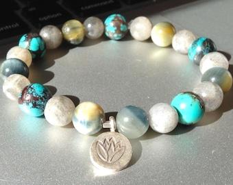 warm sun cool water.  labradorite golden blue tiger eye turquoise gemstone mala bracelet