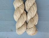 Two skeins of walnut dyed merino yarn