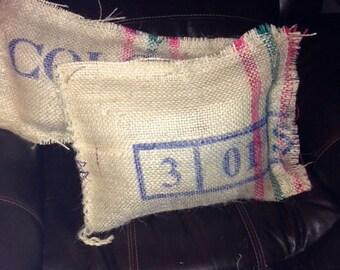 Two burlap coffee sack pillows