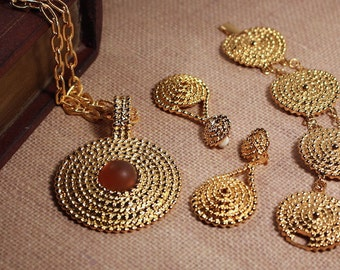 Avon gold tone medallion necklace, clip earrings, bracelet - vintage 1992