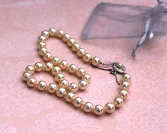 Hand knotted Majorica man made pearl necklace with a sterling silver clasp