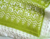Knitted baby blanket with fleece lining.