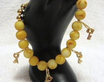 Yellow Macrame Beaded Bracelet With Key Charms