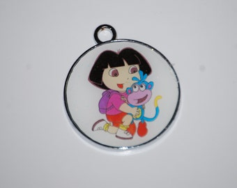 Dora the Explorer and Boots Round Enamel Clip Charm, zipper pull, backpack, cell phone, purse clip, bracelet, necklace or scrapbooking.