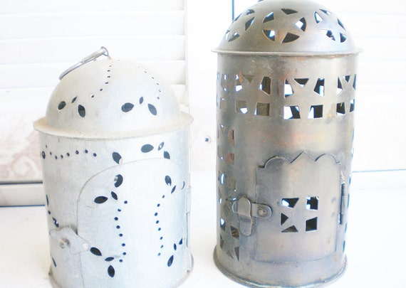 Punched metal candle holder lanterns for votives by - Punched metal candle holder ...