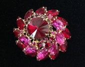 Juliana D&E Delizza Elster rhinestone round tiered brooch dimensional ruby red magenta Rivoli center prong set collectible costume jewelry