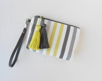 Wristlet or clutch in bright summer stripe with tassels!