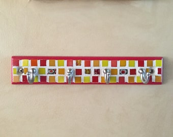 Brightly colored cute little mosaic key chain or lanyard holder on wood base