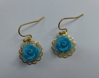 Classic gold color filigree earrings with blue cabochon rose