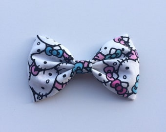 Hello kitty bow pink and blue hello kitty