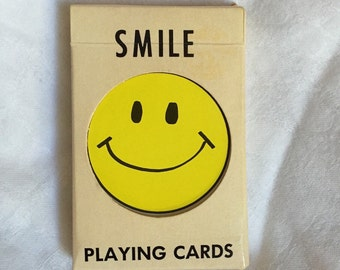 Fantastic 60s happy face playing cards yellow