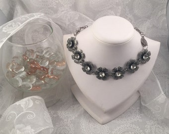 Silver  tone chain necklace, with crystal center flower componants