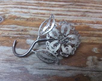Vintage silver filligree flower brooch