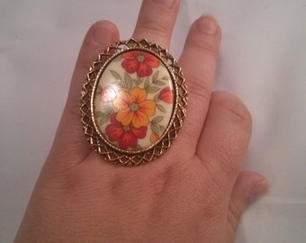 Altered Oversized Floral Plastic Cabochon Brooch into a bronze metal color Adjustable Ring