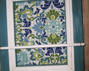 Beautiful blues greens and white with a distressed blue frame with white trim