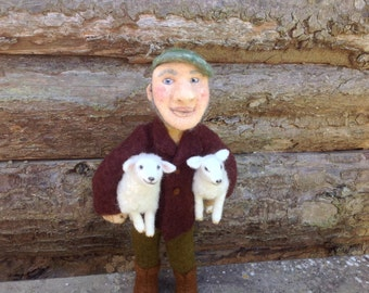 Needle felted farmer with his lambs