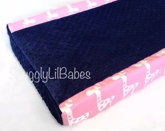 Pink giraffe, navy minky dot changing pad cover