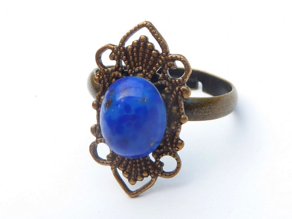 antique ring with lapis lazuli in blue bronze ring