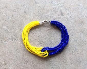7 1/2 inch handmade loop seed beaded bracelet.