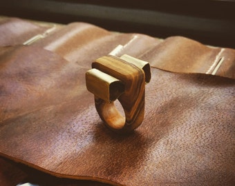 Bronze bow. An olivewood ring.