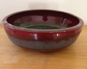 Medium- large sized red and green handmade bowl