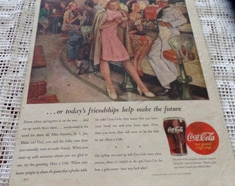 Original 1945  Coke/ Coca Cola ad.  Features a group of soldiers with girls at a diner