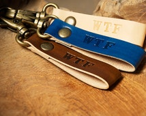 Leather keychain, belt loop, bag charm or zipper pull with abbreviation WTF