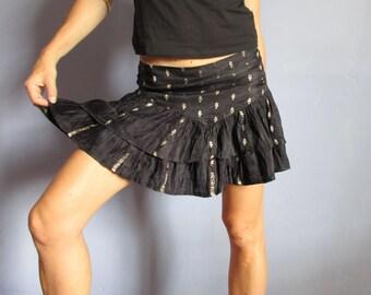 Mini skirt in black satin
