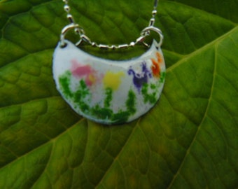 Wildflowers blooming across a copper enameled necklace