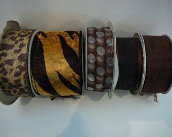 5 partial rolls of ribbon in golds, blacks and browns