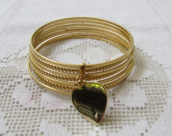 Vintage 60s 7 joined skinny bangles with heart dangle charm  bracelet  gold plated