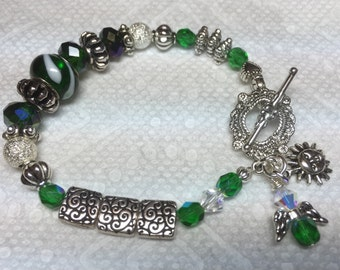 May Birthstone Beaded Bracelet with Toggle Clasp. Sun and Angel Charms.  Swarovski Elements