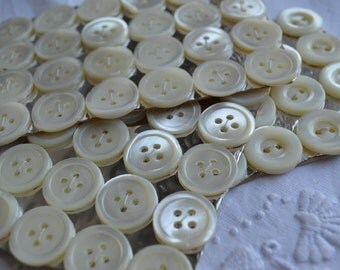 Card of 24 MOP buttons from the 1940s 13/16 inch