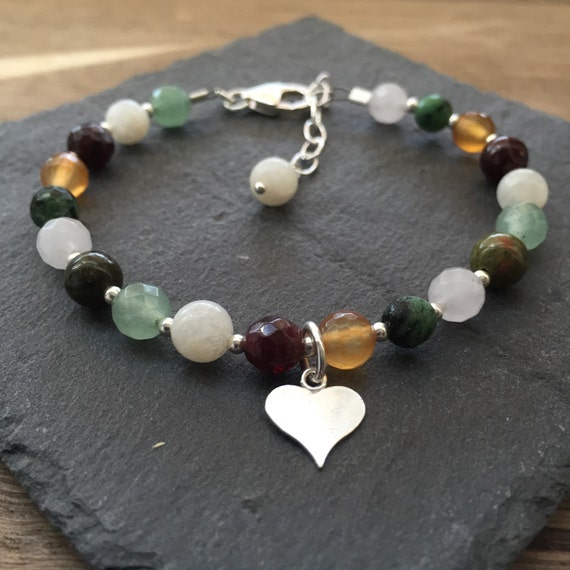 fertility bracelet with charm and gemstones by