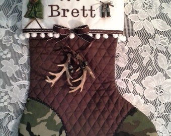 Hunting Christmas stocking customized with name and comes with assorted hunting ornament and horns depending  on availability.