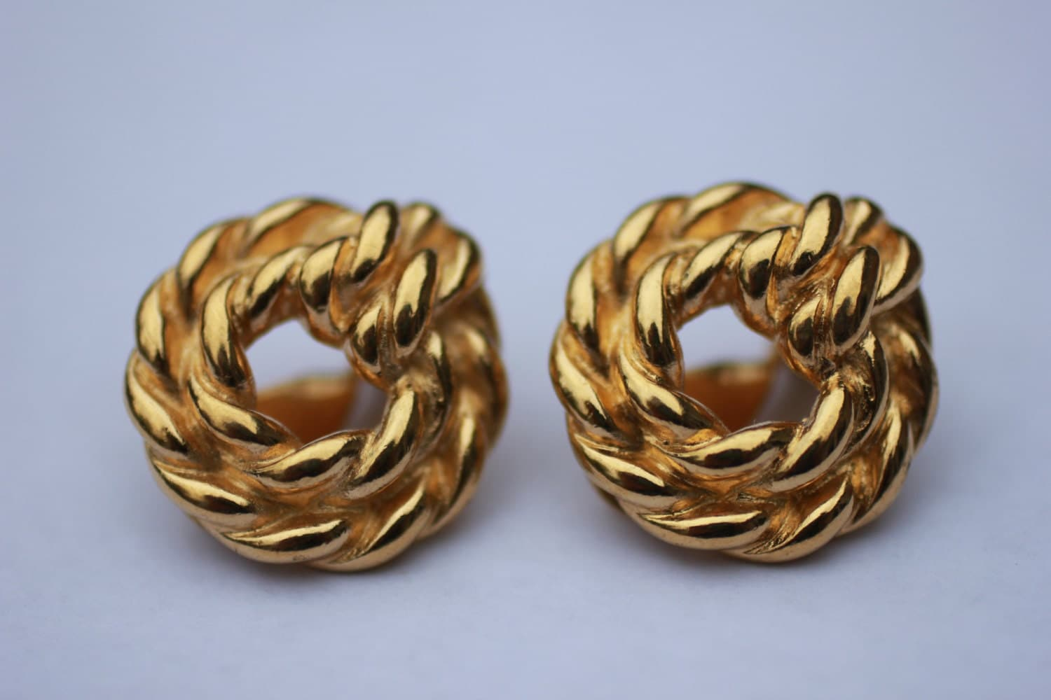 gold tone vintage monet clip on earrings by