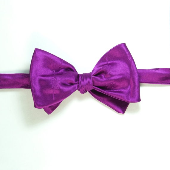 bow tie made of magenta colored silk floral jacquard with palm