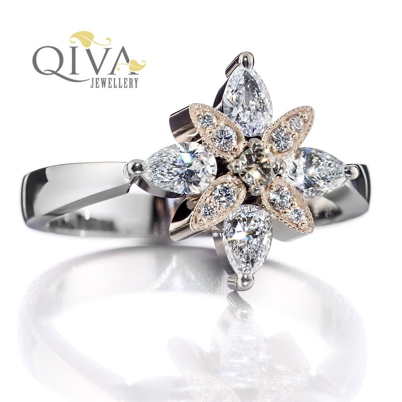 ready to ship unique engagement ring pear by qivajewellery