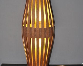 Floor bright lamp made from bent plywood.