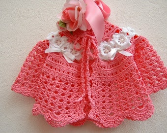 Crochet baby sweater. Pink cotton with white roses in Ireland. Crochet baby girl. Baby fashion spring-summer. Romantic style