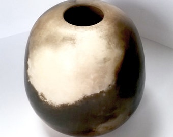 Stoneware hand thrown pot with sawdust fired finish