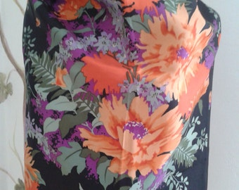 Vintage Christian Dior scarf in vivid colors on a black background