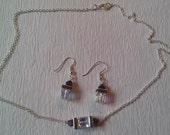 Necklace & earrings of Swarovski crystal cubes hugged by amethyst squaredelles and metallic purple bicones on a silver chain