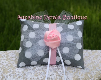 Handmade gray with white polka dot print fabric ring pillow trimmed in pink and white.