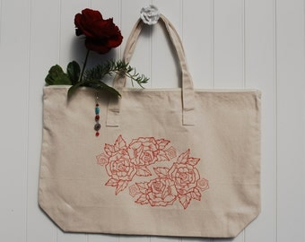 Cotton canvas zippered tote bag embroidered with a red rose and a beautiful zipper pull.